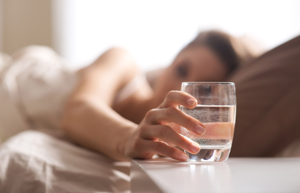 should you drink water before bed
